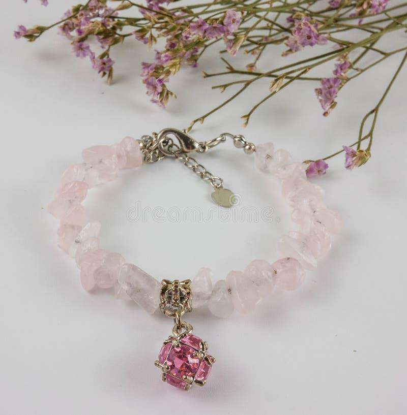 Rose quartz bracelet on white background royalty free stock images