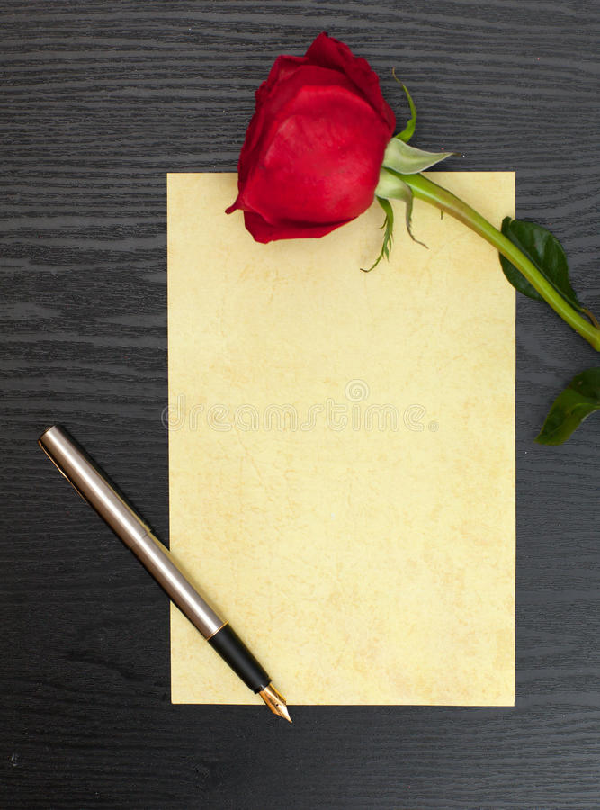 Rose and sheet of paper royalty free stock image