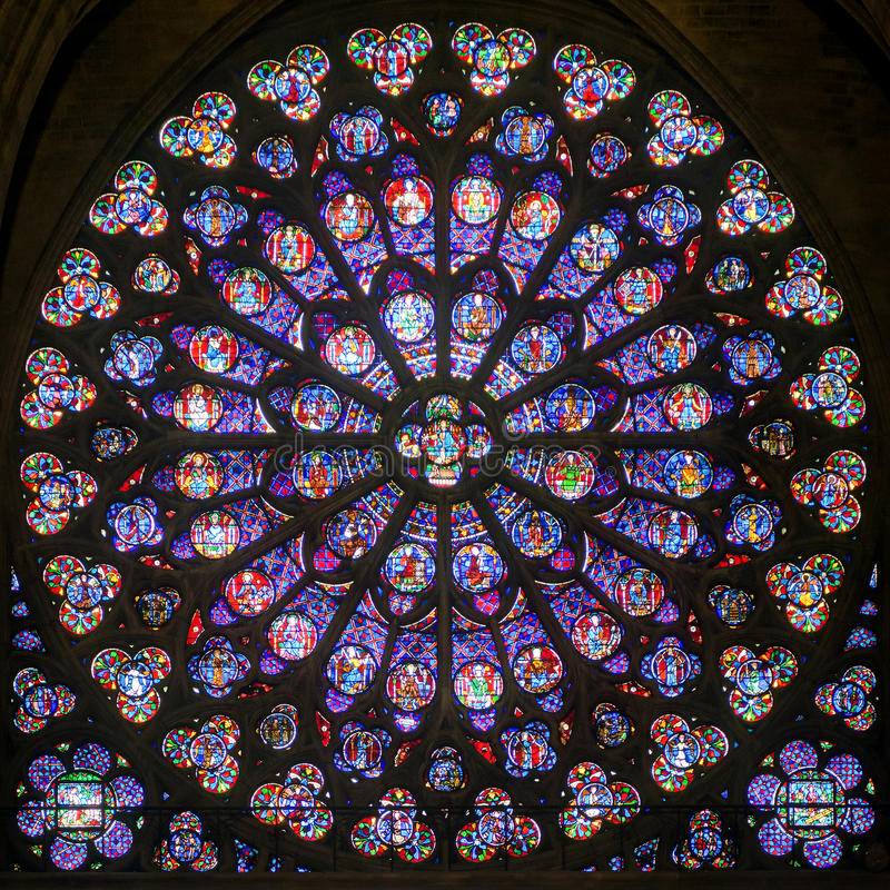 Rose stained glass window in the cathedral of Notre Dame de Paris royalty free stock photo