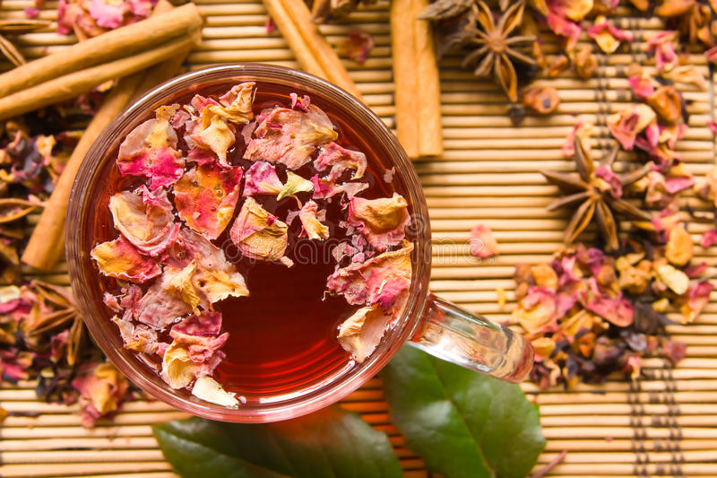 Rose tea. A glass cup of rose tea with spices. View from above royalty free stock photo