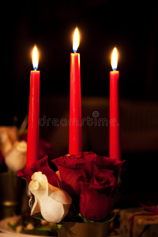 Rose and three candles royalty free stock photography