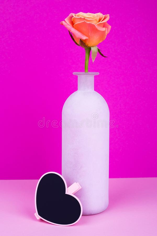 Rose in vase, wooden heart for text royalty free stock photography