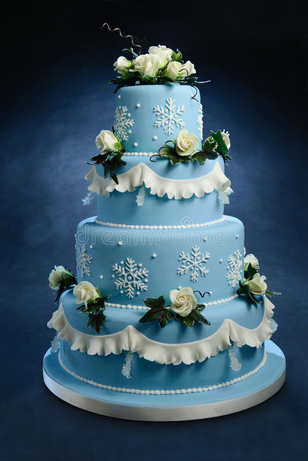Rose wedding cake. Romantic blue wedding cake decorated with hand made frosted sugar roses, snow cristals and sugar cristals