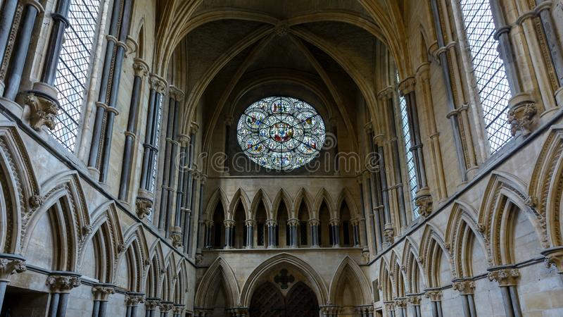 Rose West Window and Ceiling of Chapter House, Stained Glass in. Lincoln, England - Nov 17, 2017: Rose West Window and Ceiling of Chapter House, Stained Glass in stock photography