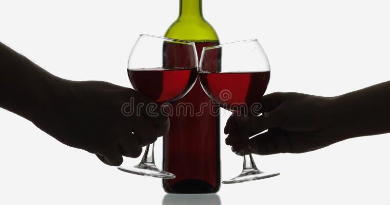 Rose Wine Rode wijn in twee wijnglazen over witte achtergrond stock afbeelding