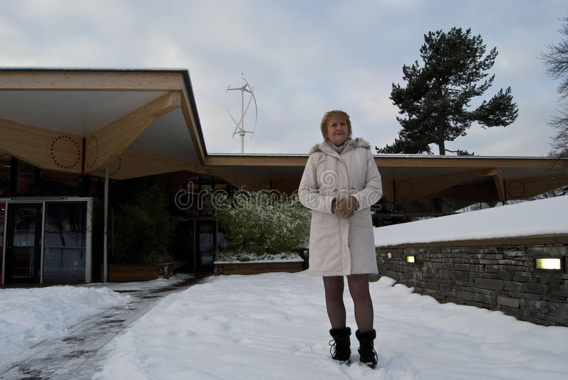 Roseanna Cunningham MSP. UK SCOTLAND Edinburgh -- 23 Dec 2010 -- Scottish Climate Change Minister Roseanna Cunningham poses in front of a quiet wind turbine at royalty free stock image