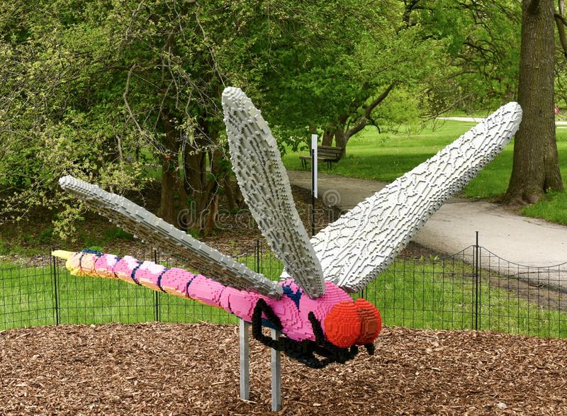 Roseate SkimmerDragonfly. This is a Spring picture of a piece of public art titled: Roseate Skimmer Dragonfly, on exhibit at the Morton Arboretum in Lisle royalty free stock photography
