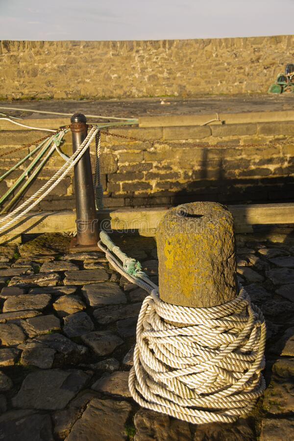 Old Mooring post at Rosehearty Harbour,Aberdeenshire,Scotland,UK. Rosehearty has two harbours, the old harbour formed of two stone piers and 2 acres in extent stock photography