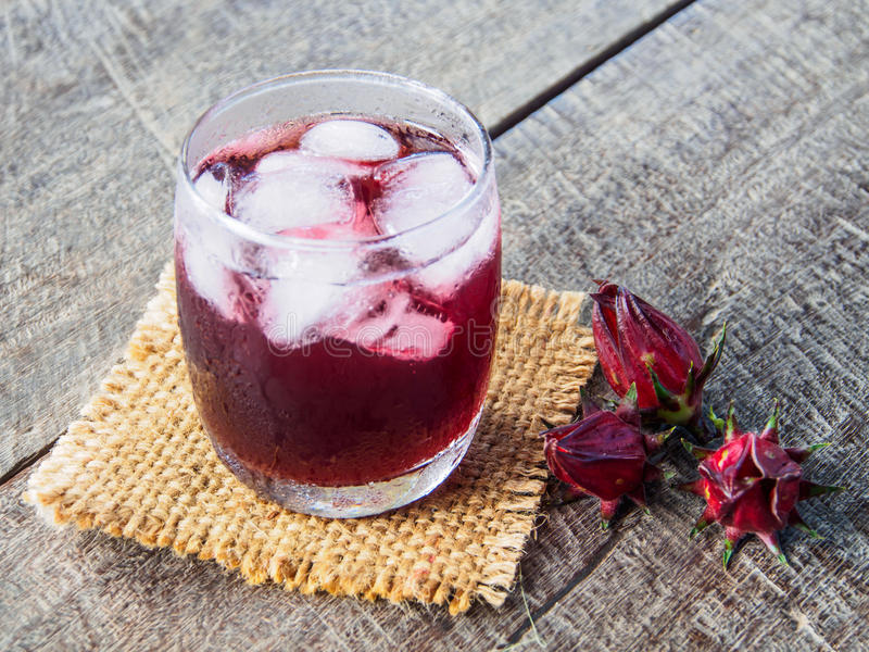 Roselle juice and ice in glass on sack stock images