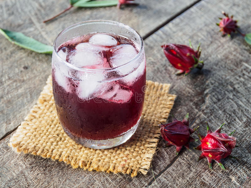 Roselle and roselle drink on wooden background royalty free stock photos