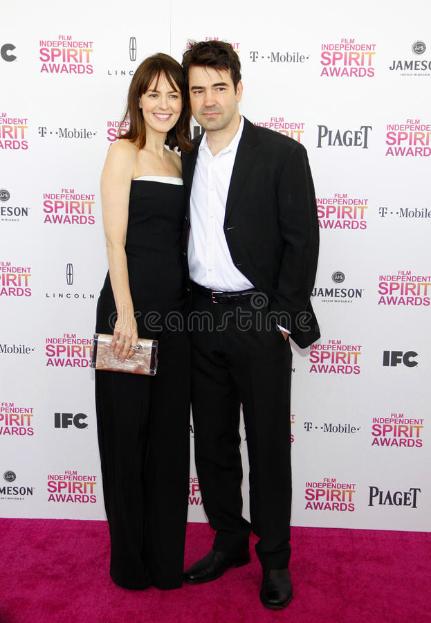 Rosemarie DeWitt en Ron Livingston stock afbeelding