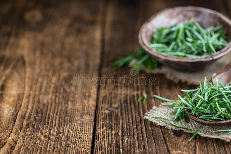 Rosemary. (close-up shot; selective focus) on a vintage background royalty free stock image