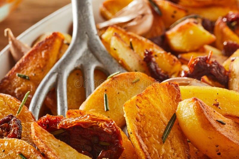 Rosemary fried potato wedges royalty free stock photos