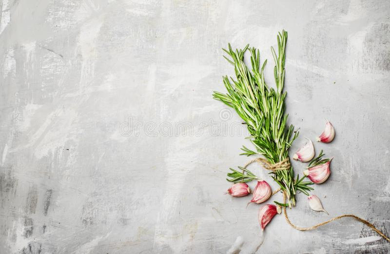 Rosemary and garlic,food background, top view royalty free stock photography