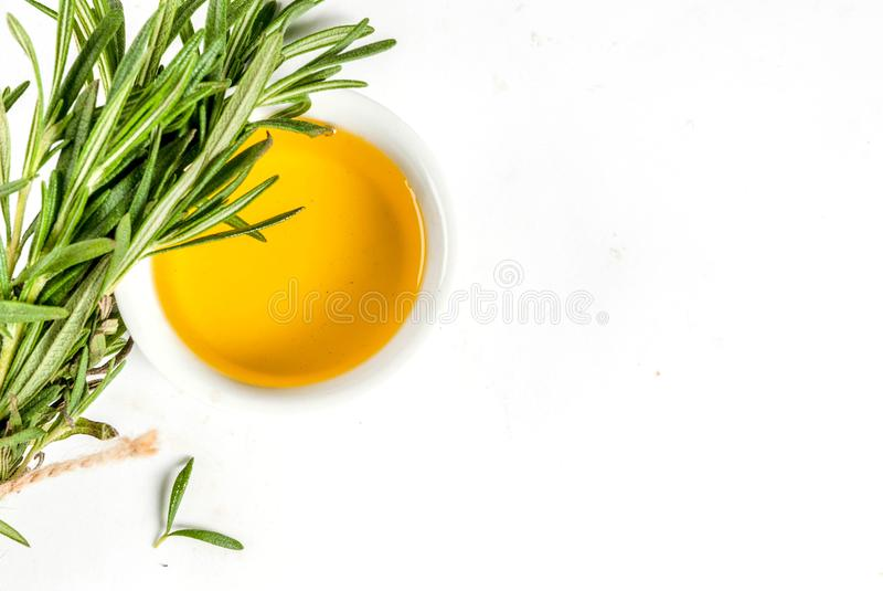 Rosemary and olive oil. Herbs and spices. Rosemary and olive oil on white background, top view copy space isolation stock photography