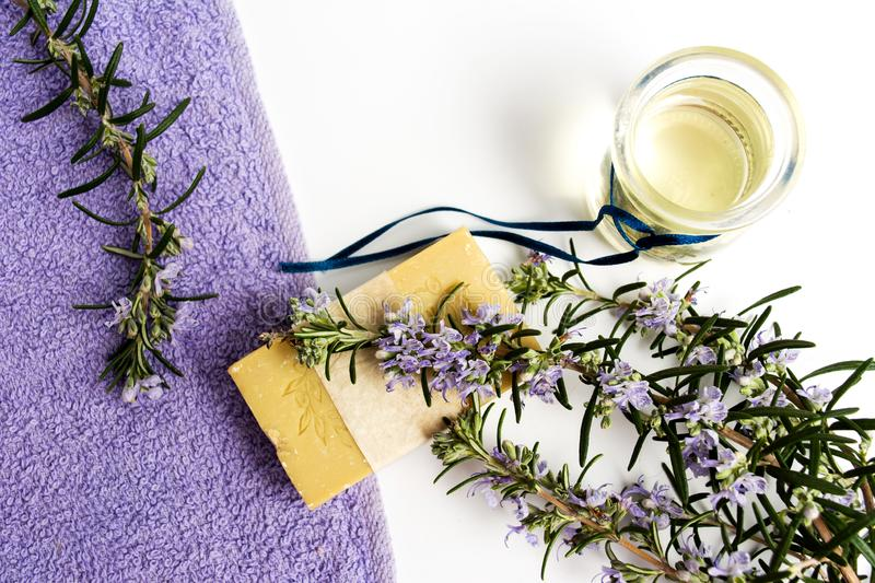 Rosemary plant natural soap with towel stock photo