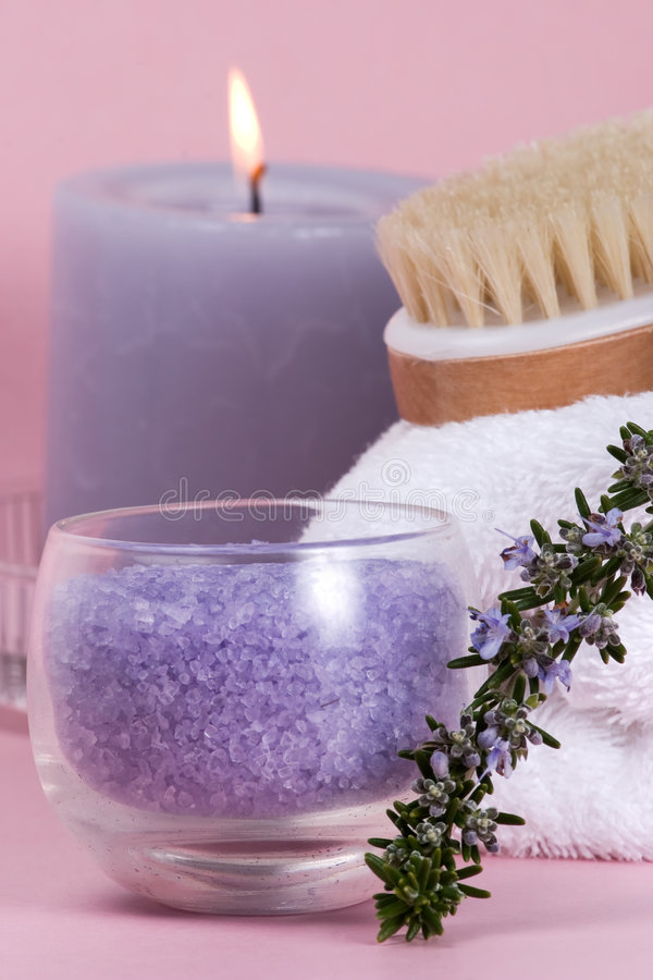 Rosemary spa set. Spa set with rosemary with copyspace over pink paper background best suited for relaxing and health commercials royalty free stock photo