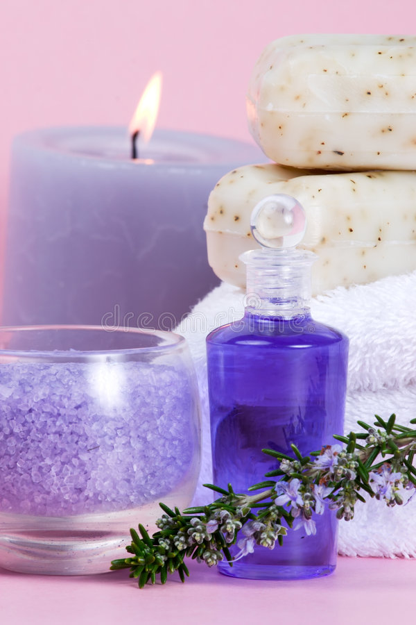 Rosemary spa set. Spa set - aroma candle, salt, oil and organic soap - with rosemary over pink background best suited for relaxing and health commercials stock photo
