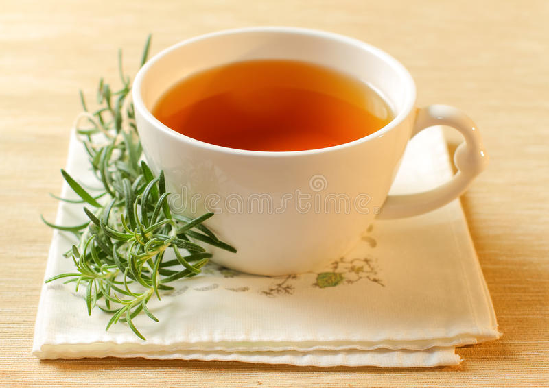 Rosemary tea. In a white cup. Selective focus royalty free stock images