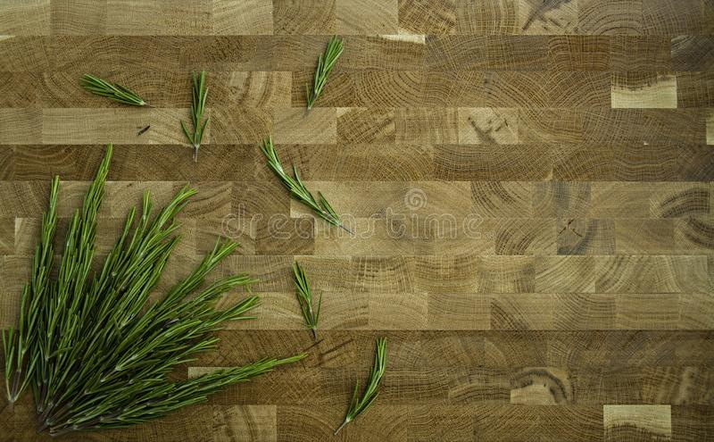Rosemary on a wooden background. Dark background. royalty free stock photo