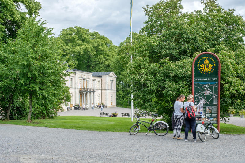 Rosendal Palace, Stockholm. Stockholm, Sweden - July 5, 2017: Tourists with bikes at Rosendal palace in Stockholm. Rosendal palace located in the recreational stock images