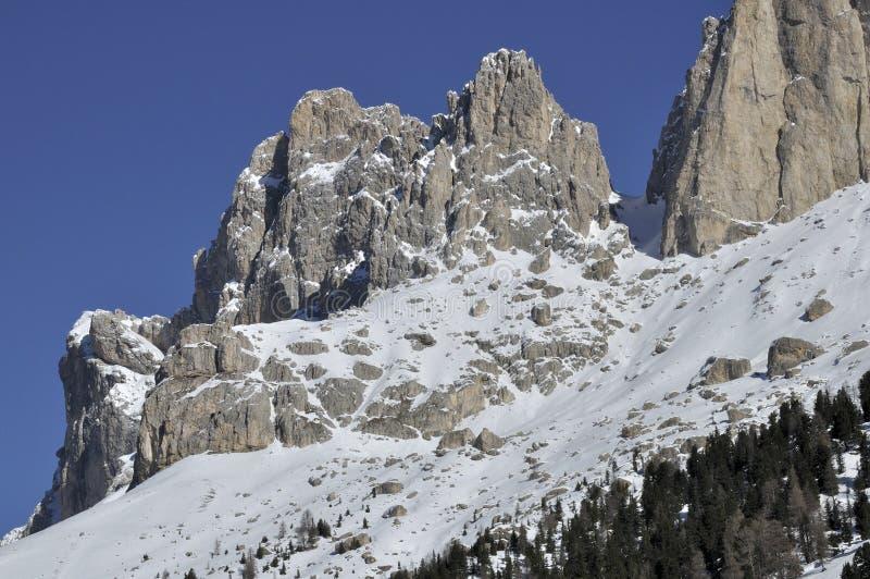 Rosengarten peak, dolomites. Scenic landscape of mountain peak in winter, shot in bright light stock images