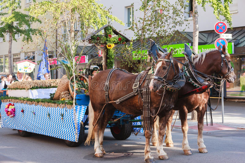 Rosenheim, Germany, 09/04/2016: Harvest festival parade in Rosenheim. Rosenheim, Germany - September 4, 2016: Parade Float with horses at Thanksgiving Parade in stock photography