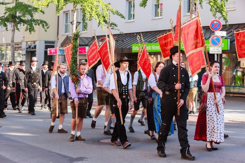 Rosenheim, Germany, 09/04/2016: Harvest festival parade in Rosenheim. Rosenheim, Germany - September 4, 2016: guild of craftsmen with standards of Rosenheim at stock image