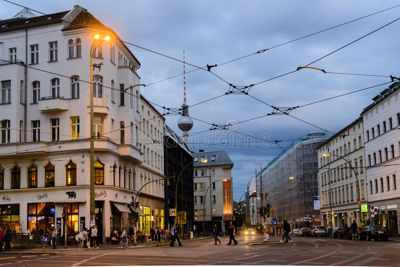 Rosenthaler Platz in Berlin. A view of Rosenthaler Platz in the evening with the Fernsehturm Berlin TV tower in the background royalty free stock images