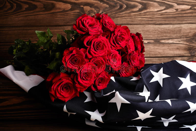 Roses on american flag. Memory. Red roses on american flag. Memory royalty free stock photos