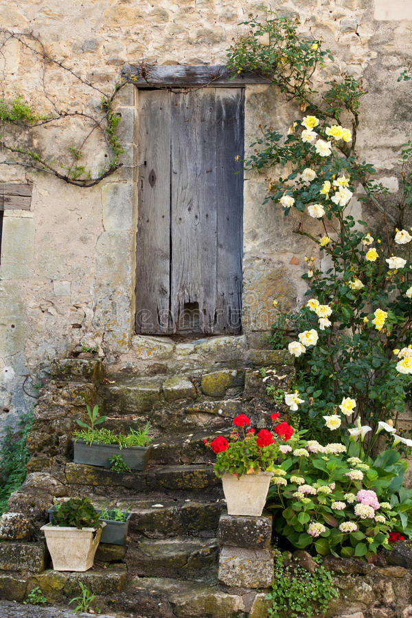 Roses around door. Cottage with roses around door royalty free stock photography