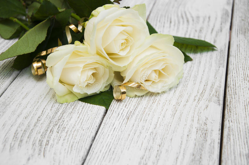Roses. Beautiful white roses on a wooden background stock photography