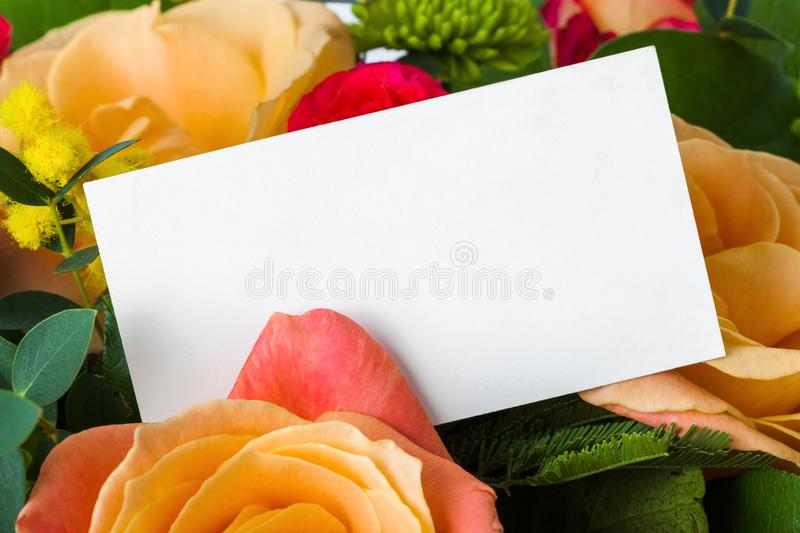 Roses bouquet and paper card stock photo