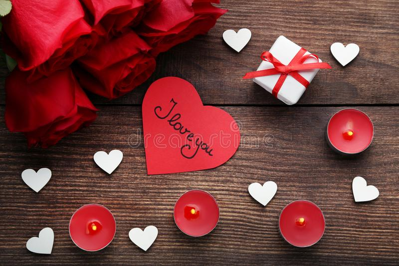 Roses with candles and white hearts stock photos