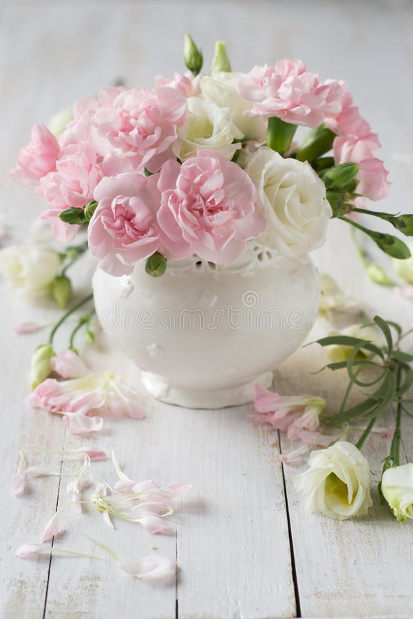 Roses and carnation in vase royalty free stock photos