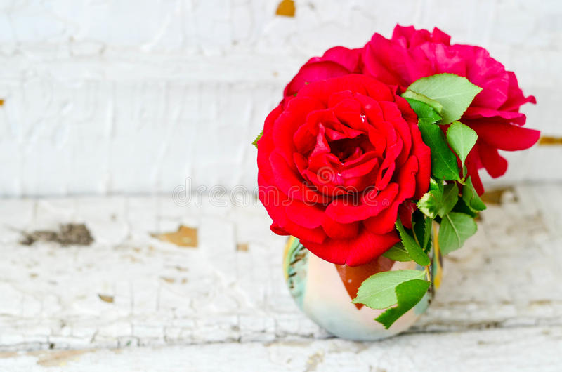 Roses. Close up of Bouquet of red roses on a wooden background royalty free stock photography