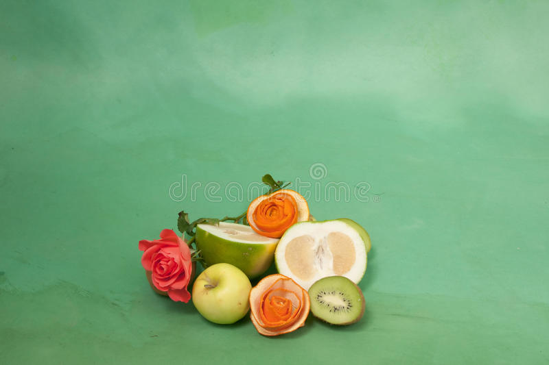 Roses and fruits on a green background. Card with roses and fruits on a green background royalty free stock photos