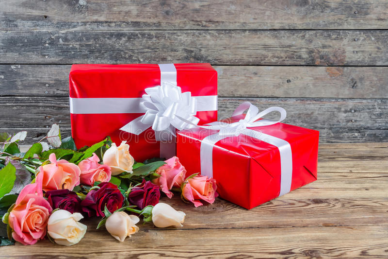 Roses and gift box royalty free stock photo
