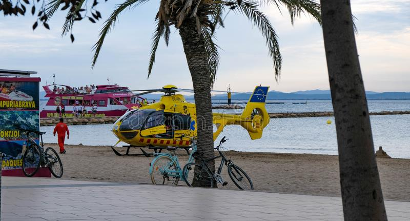 Roses, Girona, Spain- August 21, 2019: Yellow rescue helicopter on a beach royalty free stock photo
