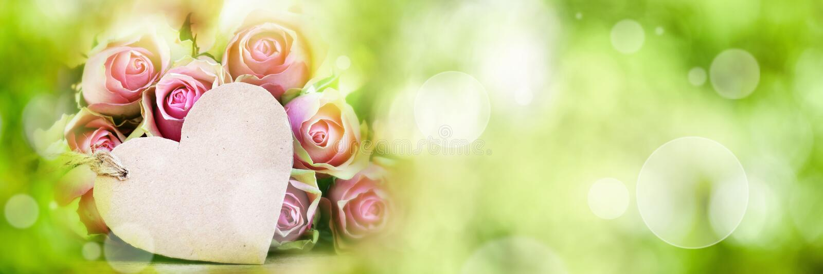 Roses with greeting card on spring background stock photography