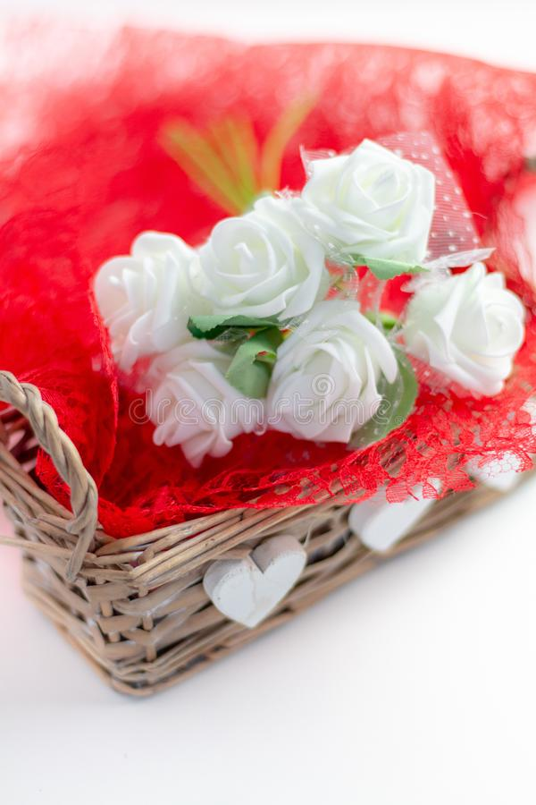 Roses and a hearts on white background, Valentines Day background royalty free stock image