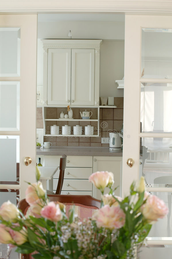 Roses in the kitchen royalty free stock images