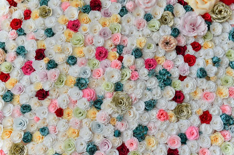 Roses paper wall background with amazing red and white roses. Roses wall background made from paper with amazing red and white roses,handmade wedding decoration stock photos