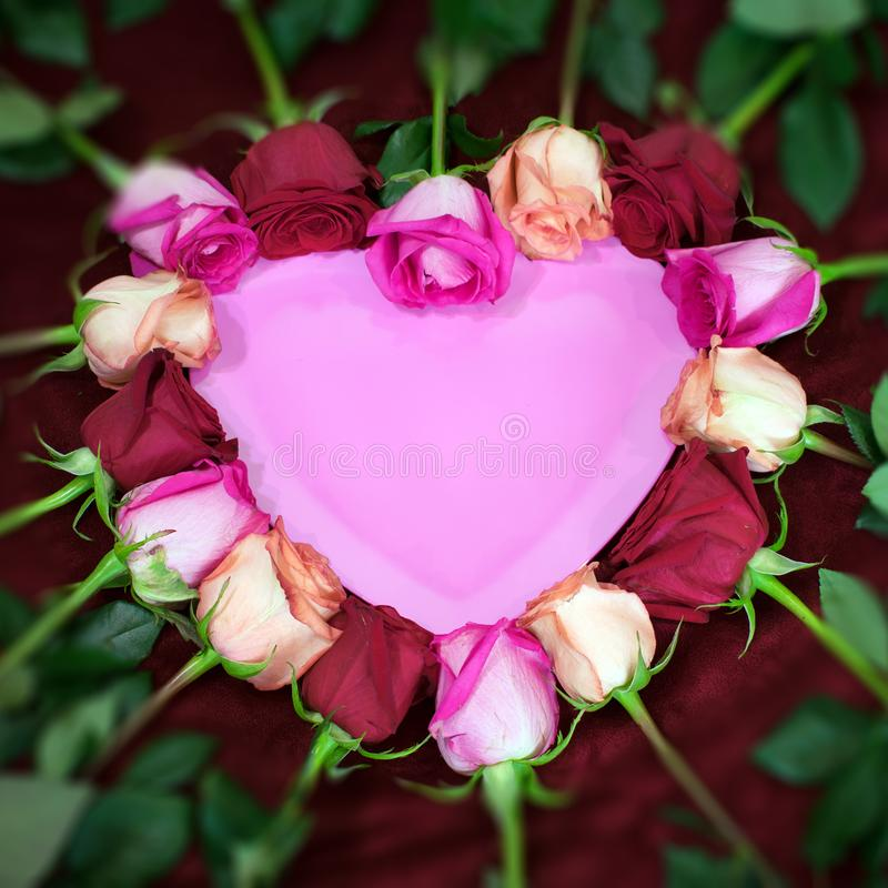 Red and pink roses form a heart shape stock photos
