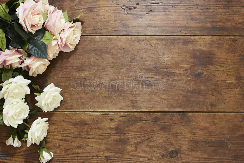 Download Roses On Rustic Wood Background Stock Photo