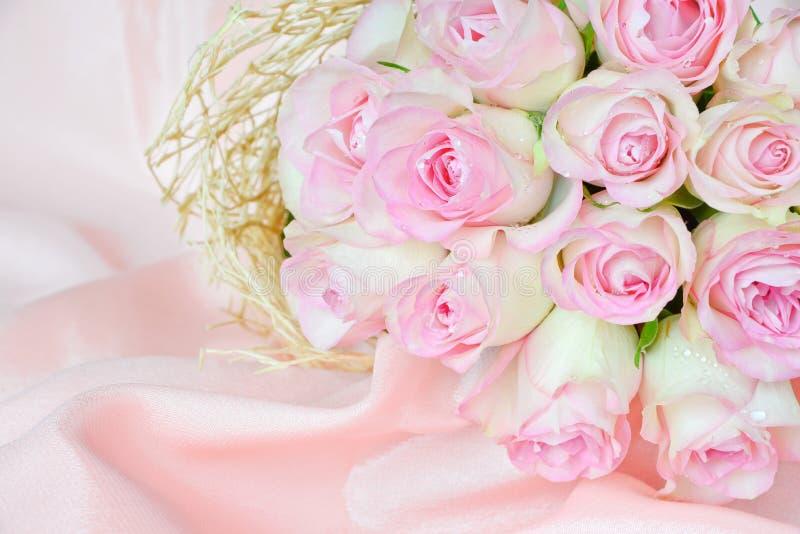 Roses on satin fabric stock photo