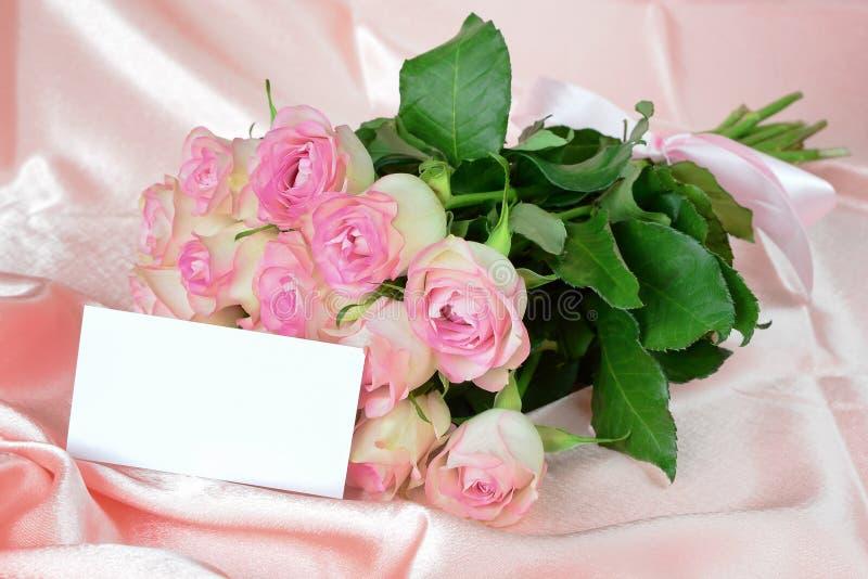 Roses on satin fabric stock photos