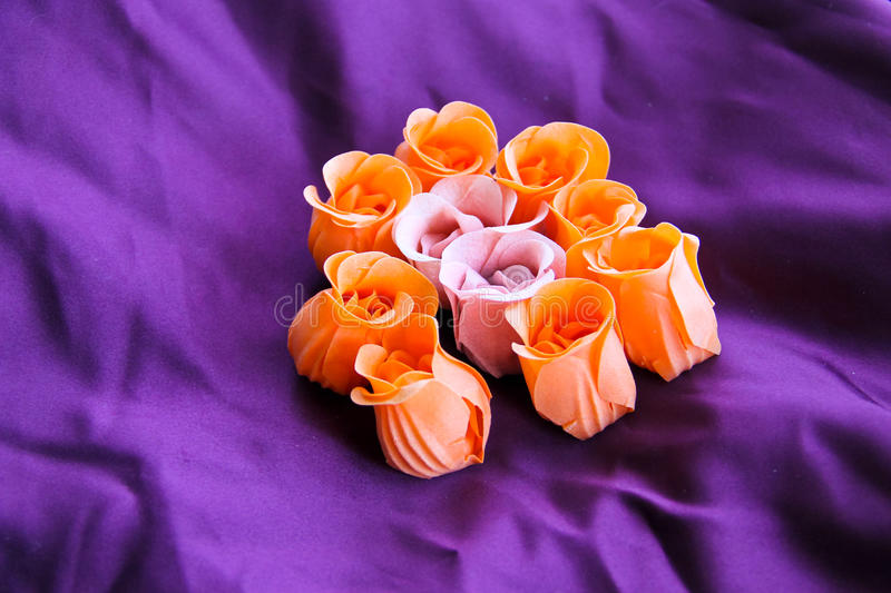 Roses shaped soap on purple silk background. Roses shaped soap on the purple silk background stock photos