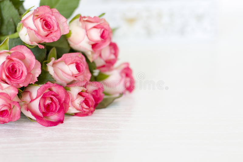 Roses. On the table pink royalty free stock photography