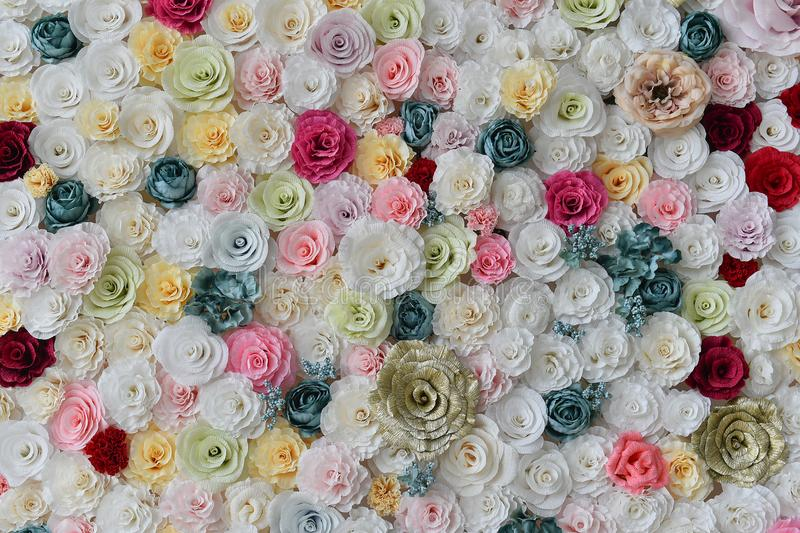 Roses paper wall background with amazing red and white roses. Roses wall background made from paper with amazing red and white roses,handmade wedding decoration stock photo